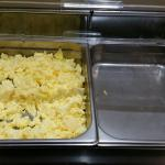 Scrambled eggs on breakfast buffet, included in stay.