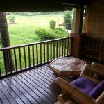 Balcony overlooking paddy field (super deluxe room)