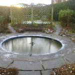 The Wishing Well in the garden frozen over...