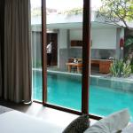 Kitchenette and dining area from room across pool