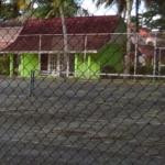 Small green building is kids club never once saw open nor anything in it for kids. Tennis court