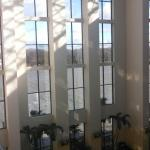 View from fifth floor atrium balcony. You can see the river through the windows.