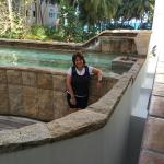 Standing in front of the hot tub pool.