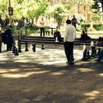 People playing chess at Hyde Park 1000' away from hotel