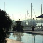 Steam rises in the morning from the heated pool, overlooking the marina