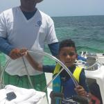 After Snorkeling w/sharks, my son asst. the Captain sail