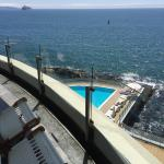 View of pool n ocean from room balcony
