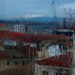 City view from breakfast area while raining