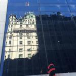 reflection of The Plaza in neighboring building