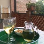 Relaxing and enjoying local wine on our balcony
