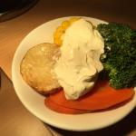 Side dish of vegetables, yes that is sour cream..