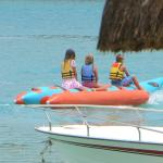 Children get a ride on an inflateable boat