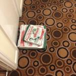 Pizza boxes left outside our room