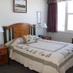 Athabasca Suite bedroom, also features a sitting room with large panoramic windows with full mou