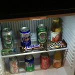 Little stocked refrigerator in the room