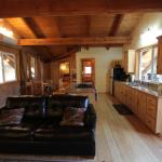 Falcon Chalet's large living room and open kitchen