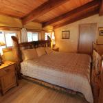 Falcon Chalet's master bedroom with hand peeled Lodgepole pine bed