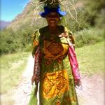 basotho woman collecting grasses to make hats for which lesotho is famous