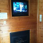 Fireplace and outdated TV in room 106
