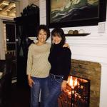 My mom and I in front of the fireplace in our beautiful cottage