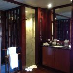 bathroom.separate shower room and toilet with marble bath tub, two big mirrors and wardrobe.