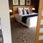 rose petals in bedroom and lovely king size bed