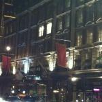 Image of The Rubens at night from the doorway of the pub across the street