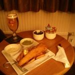 Pint and some fish and chips iny room.