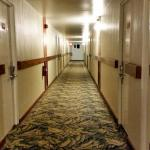 Hallway to rooms; back building