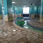 The 3rd lazy river! Beautiful murals! Also, love that there are hot tubs in the middle island of
