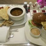 South Indian Curry and Cajun Chicken Burger room service with free cake and mints.