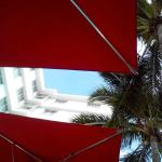 UNDER THE UMBRELLAS NEAR THE POOL, RED OF COURSE
