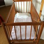 proper wooden cot provided
