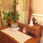 antique dresser in bathroom