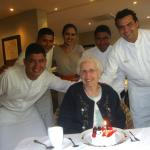 Oscar, waiters & staff helping mom celebrate her 90th birthday!