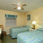 "The guest bedroom features two twin beds and a 32"" flat screen TV"