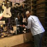 Vance McDonald of the San Francisco 49ers signs the rock star guitar in the lobby