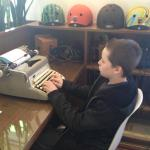 A sight I never thought I'd see.. my son and a typewriter