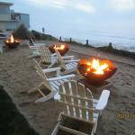 Ocean view fire pits are lit at sunset