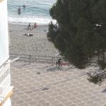 view of beach from balcony to side of the hotel