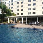 View of hotel and poolside bar from pool