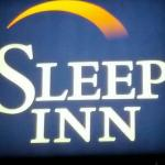The sign of the Sleep Inn at night