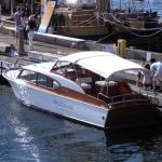 Restored vintage Chris Craft boat available for tours.