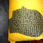 Digital Artwork on pillow on couch in room