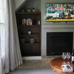 Lounge area with TV, fireplace and complimentary wine