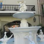 Partial view of the courtyard fountain and a room's balcony