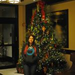 Myself in front of their Christmas tree