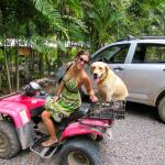 Lu and her pup Olivia in the parking area at RPV. Most people in Santa Teresa get around via ATV