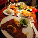 Veal schnitzel with potato salad ordered with an extra side of fries. Schnitzel was very very go