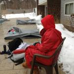 Lifeguard in winter jacket at outdoor pool!